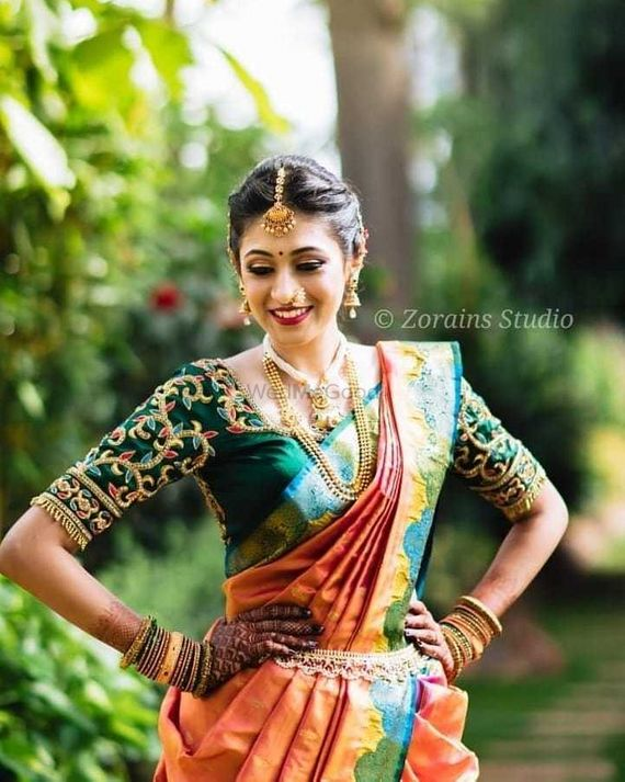 Photo of South Indian bride in green and orange saree