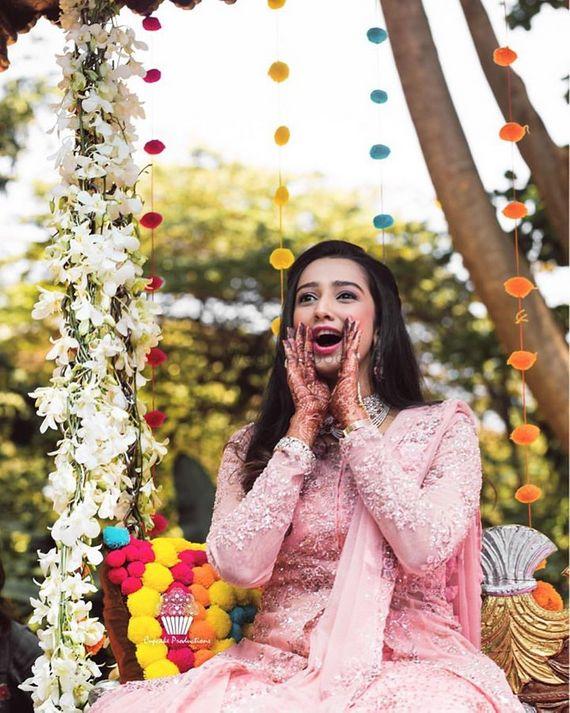 Photo of Candid bridal shot on bridal jhoola