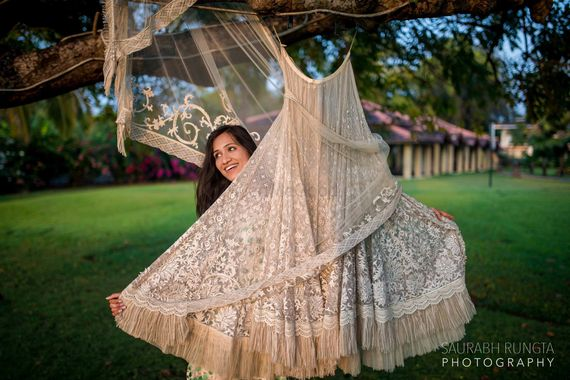 Photo of Gold Tissue Hanging Lehenga with the Bride