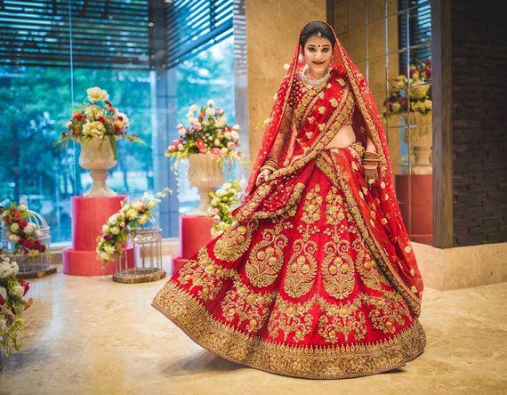 Photo of Red zardozi bridal lehenga by Sabyasachi