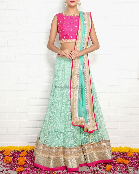 Photo of Hot Pink and Mint Blue Lehenga with Gold Border