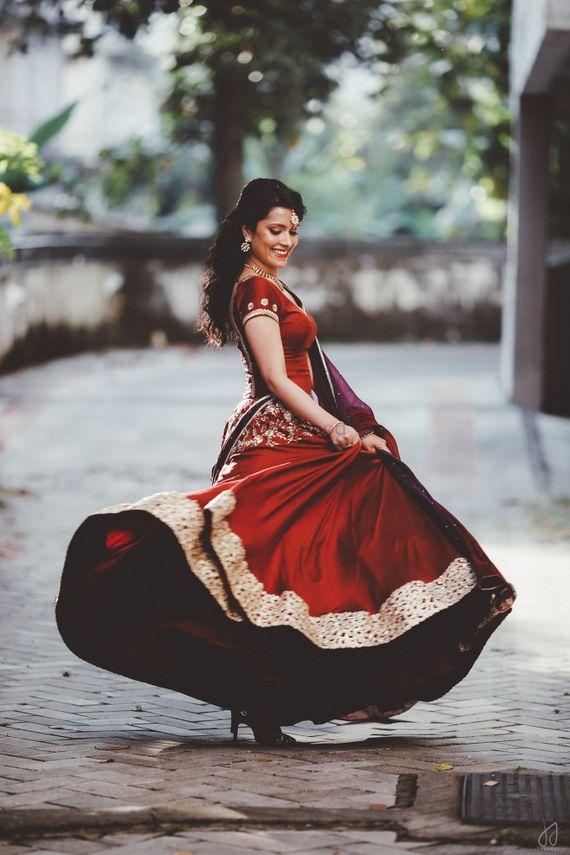 Photo of Twirling Bride - Red Lehenga