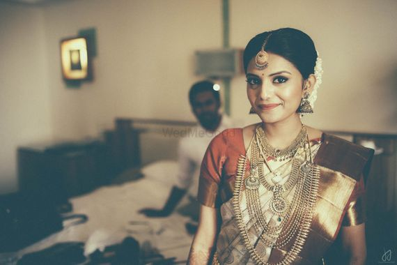 Photo of South India Bride wearing Gold Jewelry