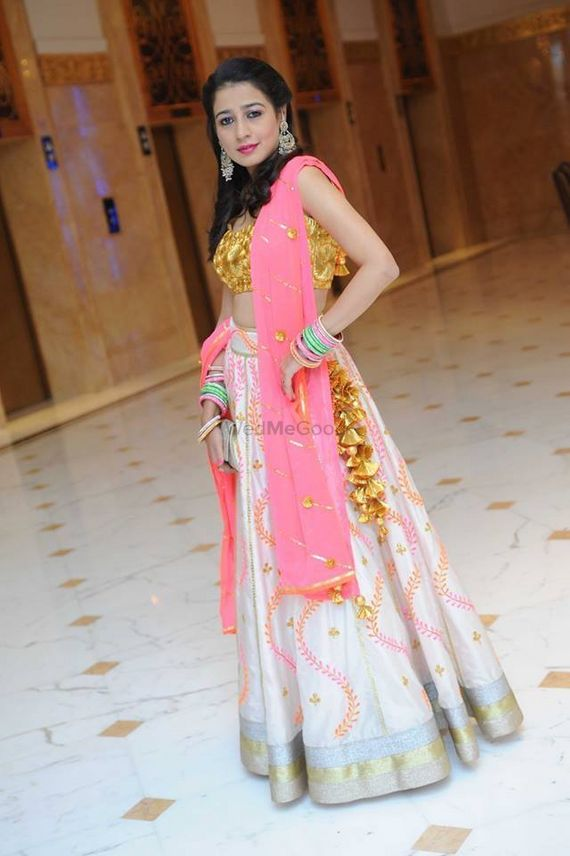 Photo of candy pink dupatta with white lehenga