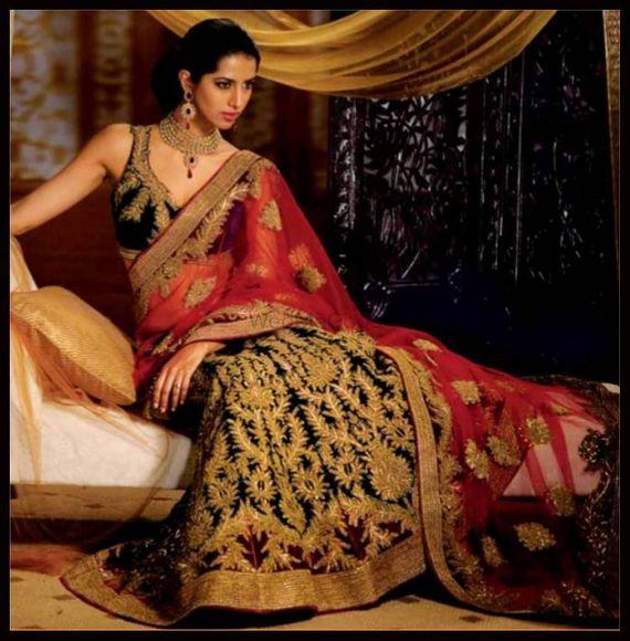 Photo of black and red bridal lehenga