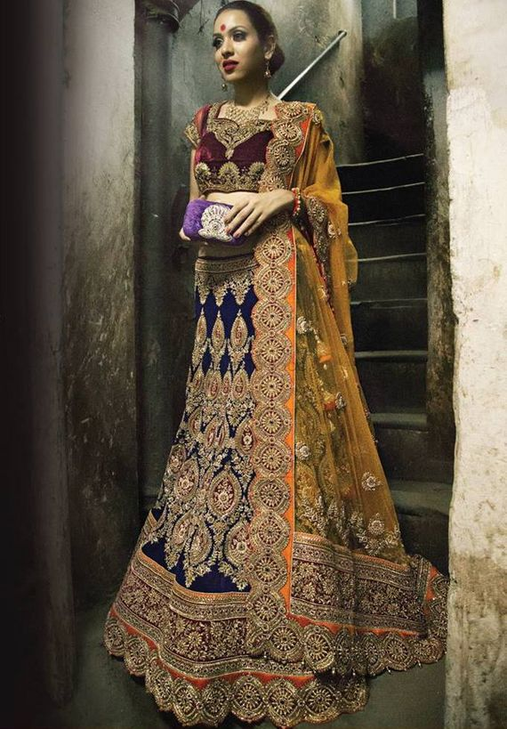 Photo of navy blue velvet royal lehenga with red maroon blouse and yellow dupatta