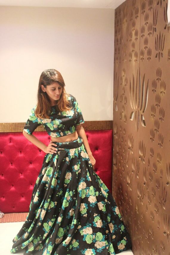 Photo of black floral print lehenga with green floral printed fabric