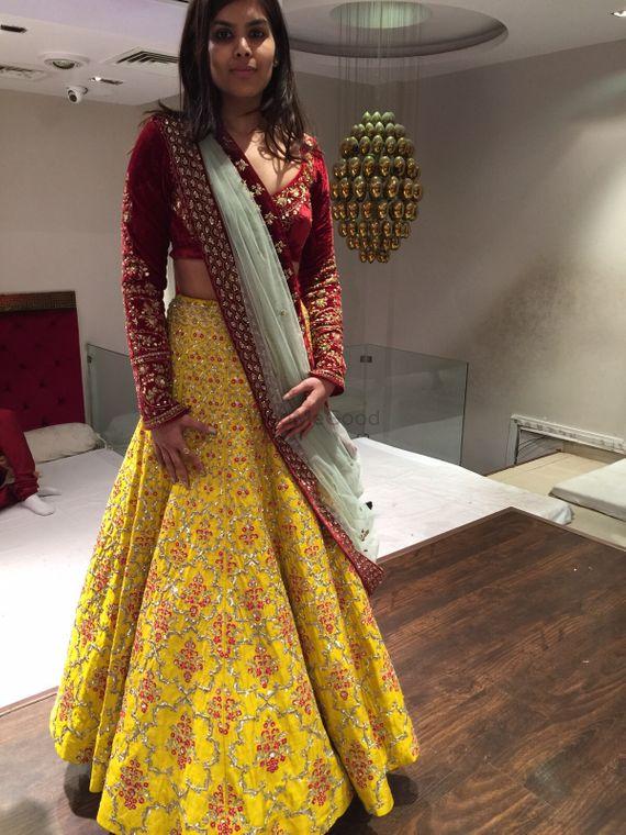 Photo of yellow and maroon bridal lehenga