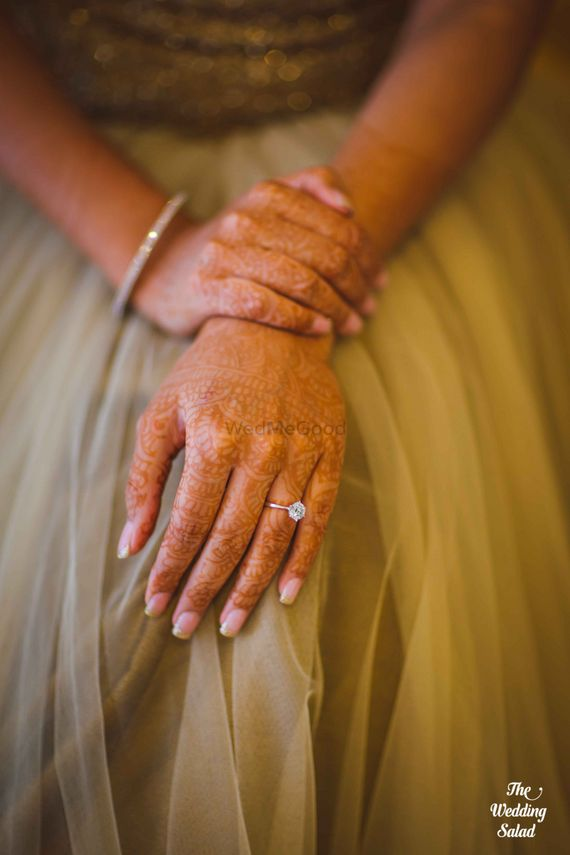 Photo of Bridal Hands with Engagement Ring and Mehendi