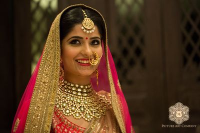 Photo of Bridal necklace with gold and red outfit