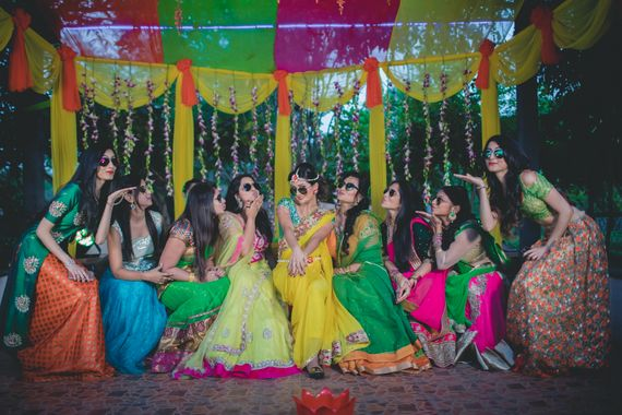 Photo of Bride with bridesmaids on mehendi day