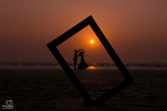 Photo of Sunset pre wedding shoot with prop and dancing pose