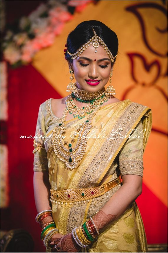 Photo of South Indian bride in yellow and gold saree
