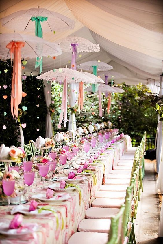 Photo of Table Setting with Suspended Lace Umbrellas