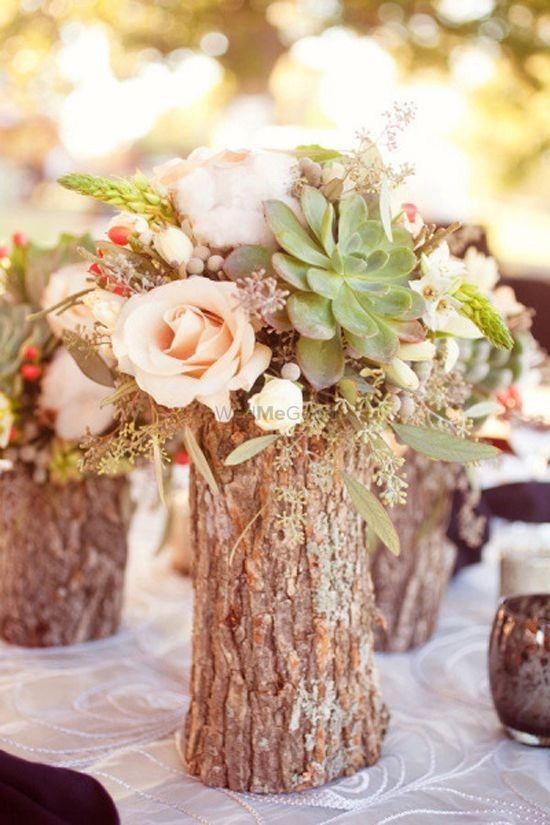 Photo of Wooden Bark Centrepiece with Flowers and Succulents