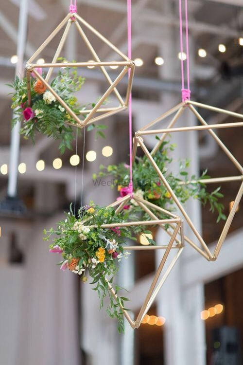 Photo of Hanging floral arrangement with wooden sticks