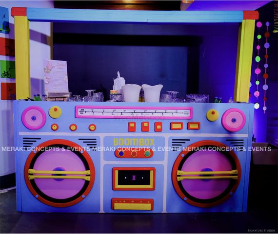 Photo of Unique radio themed bar set up for a cocktail party