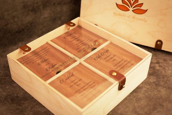 Photo of cream and red box invitations