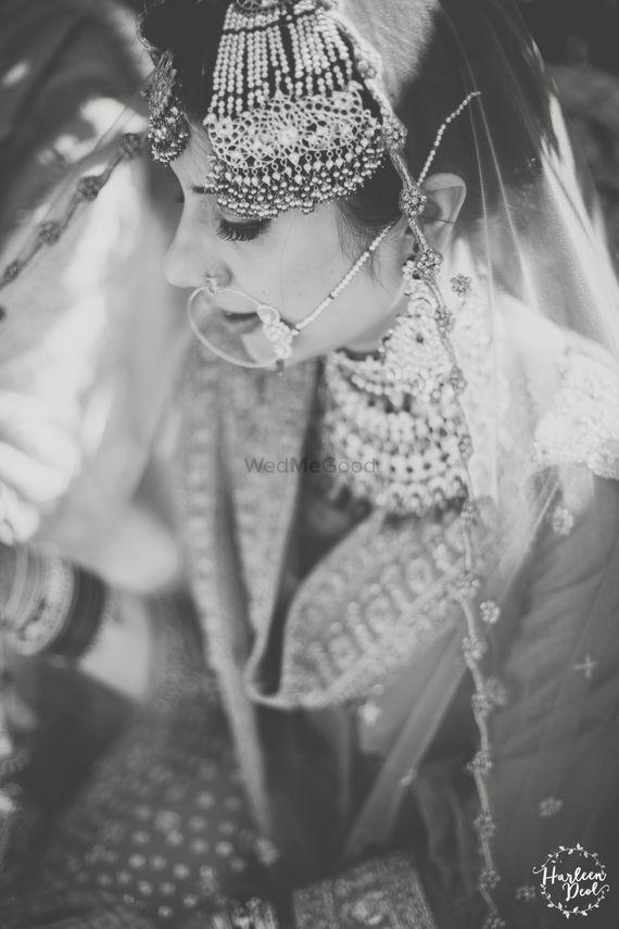 Photo of Black and white bridal portrait bride wearing jhoomer