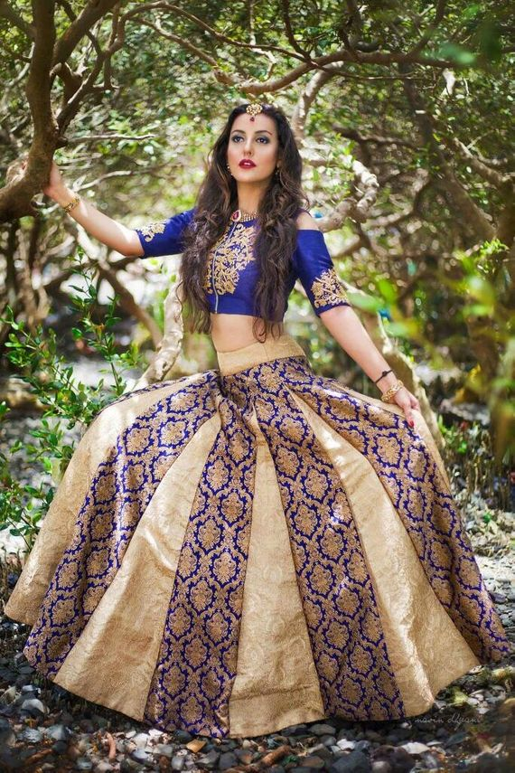 Photo of Blue and gold panelled lehenga for sangeet