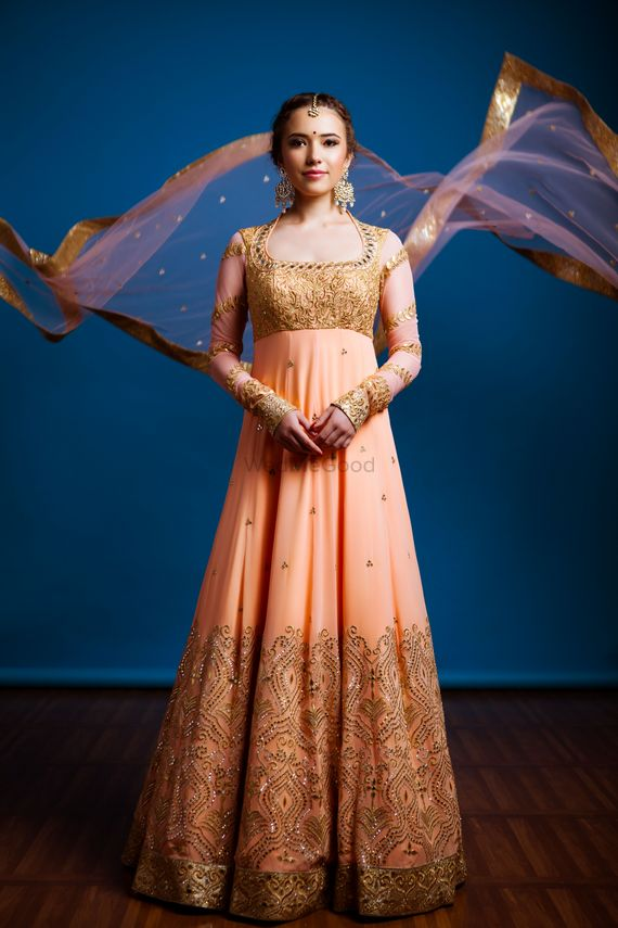 Photo of peach golden anarkali