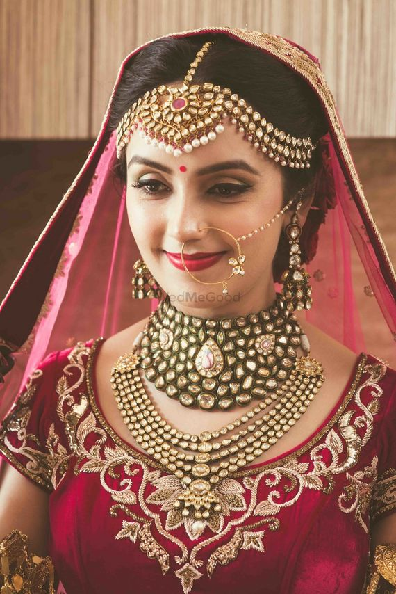 Photo of Bride wearing heavy mathapatti and necklaces