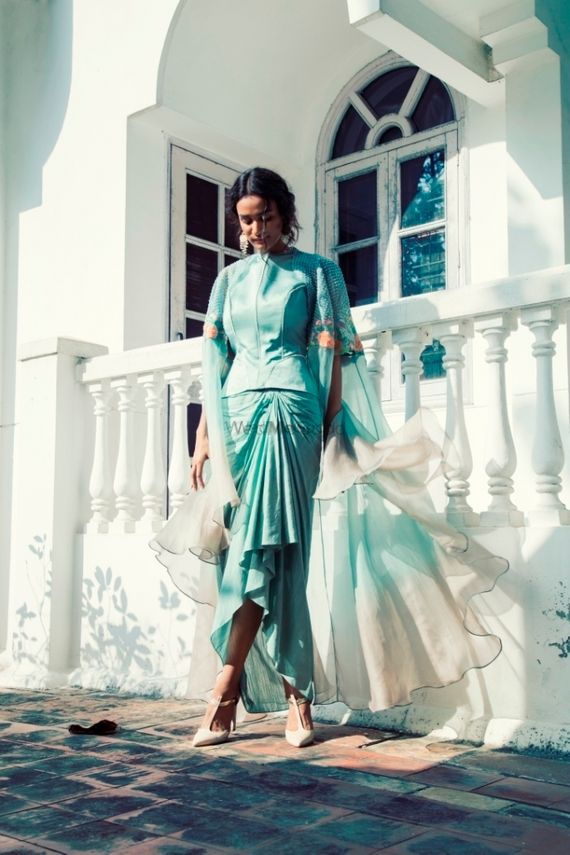 Photo of Light blue outfit with cape for mehendi or brunch