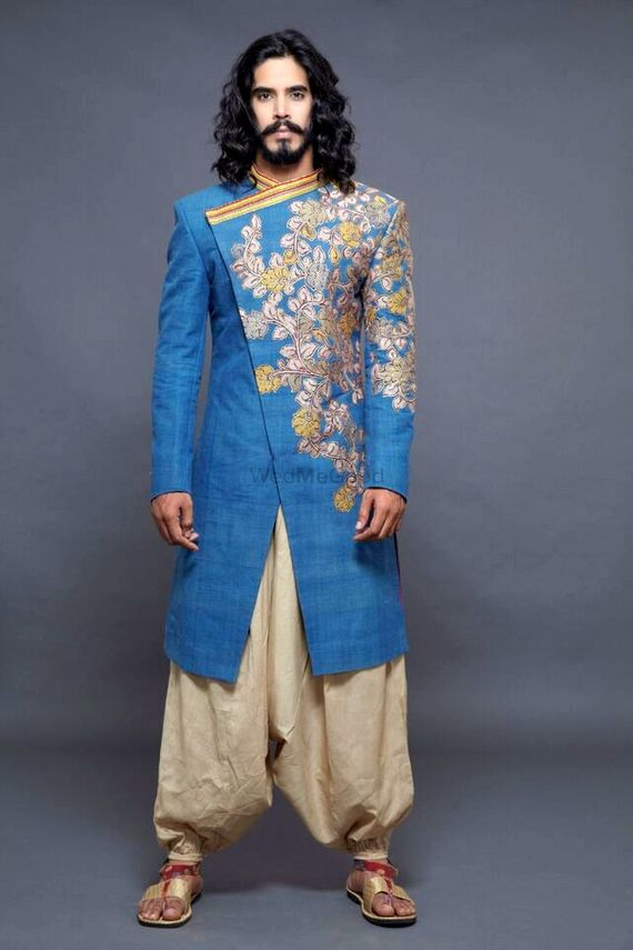 Photo of Asymmetric Sherwani with Embroidery and Dhoti Pants