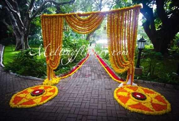 Photo of yellow - orange genda flowers  entrance