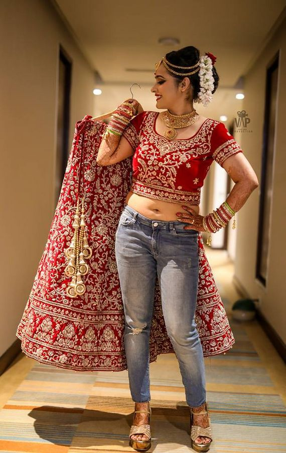 Photo Of Cute Bride In Jeans And Red Lehenga