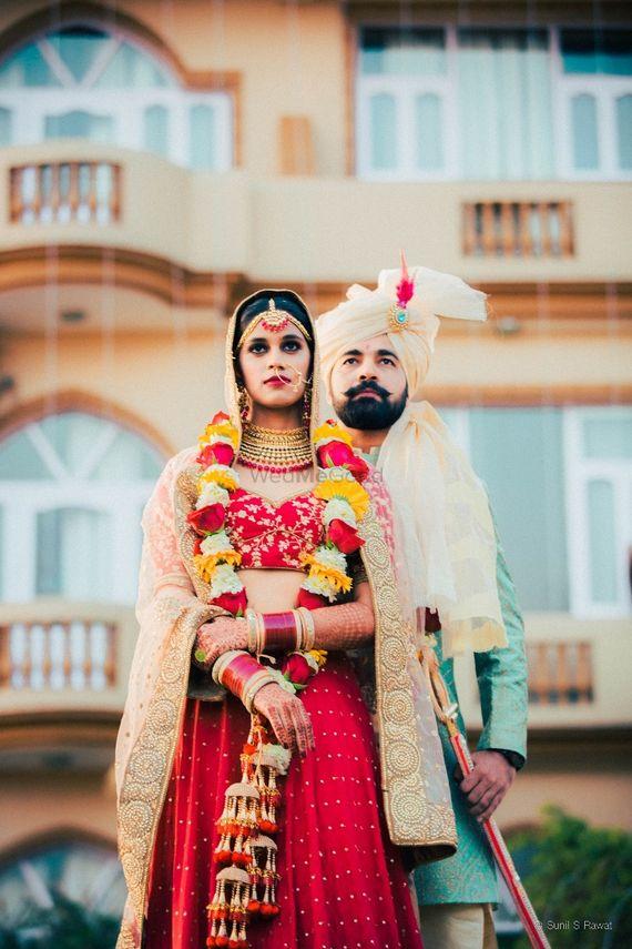 Photo of Wedding day couple shot with unique jaimala