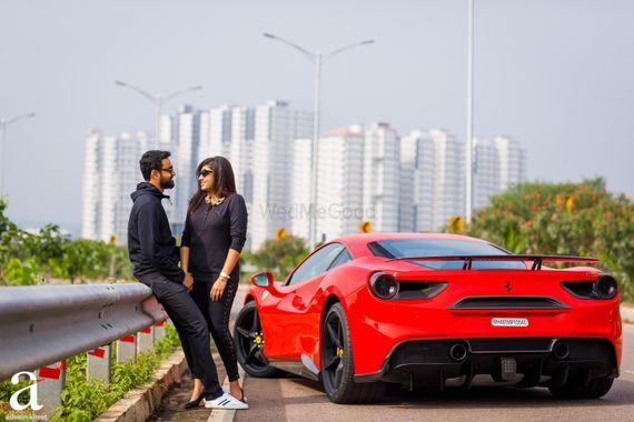 Photo of Luxury car themed urban pre wedding shoot