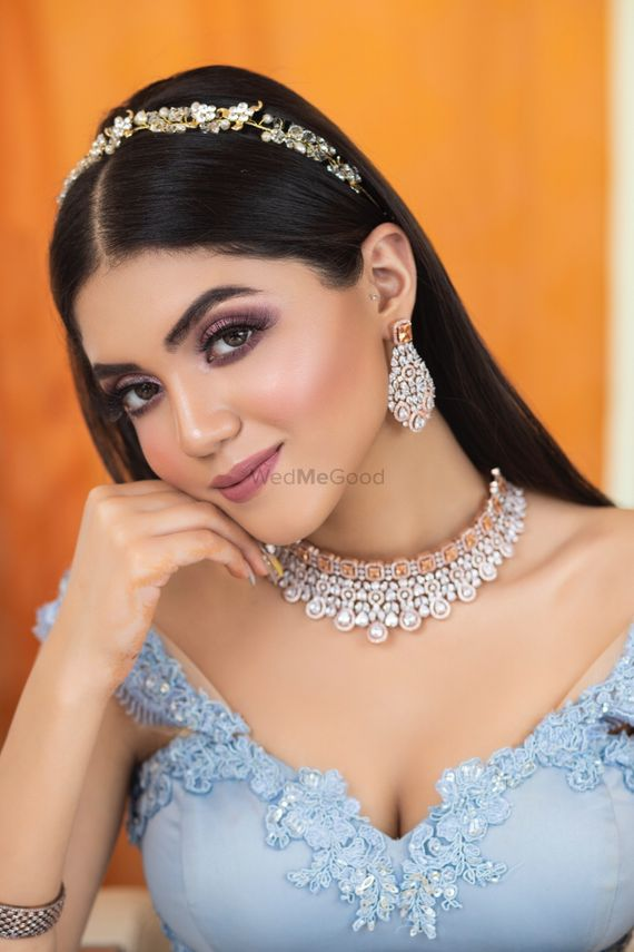 Photo of A beautiful bride in subtle makeup and jewellery on her engagement.