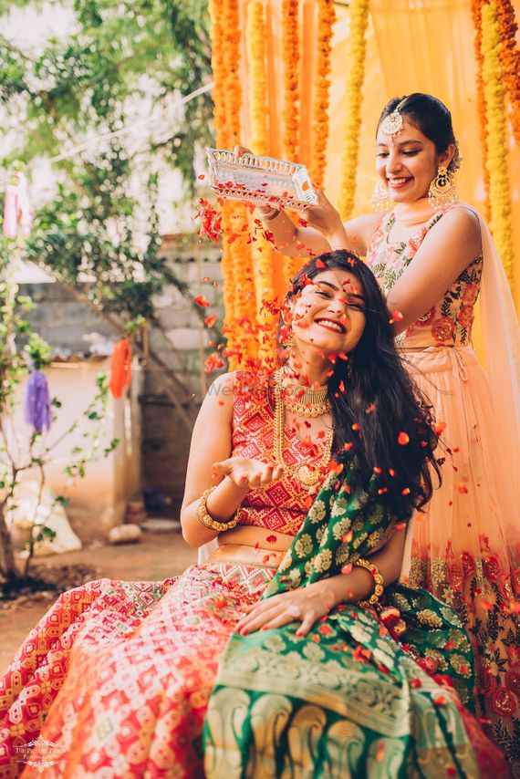 Photo of A bride caught in a candid moment with her sister