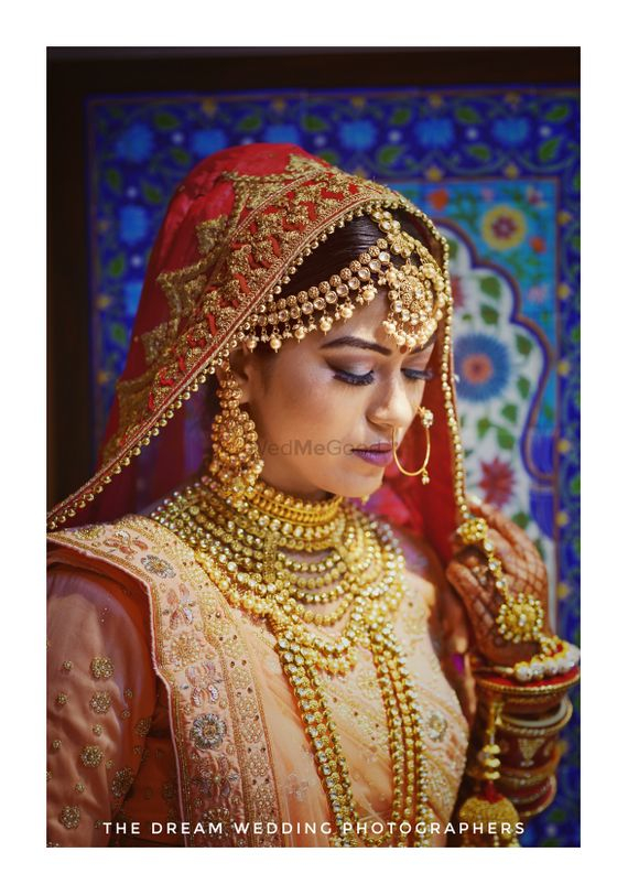 Photo of A beautiful bride at her wedding with amazing jewellery.