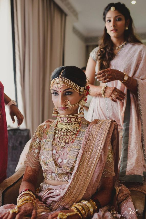 Photo of Bridal jewellery idea with maroon choker and layered necklace