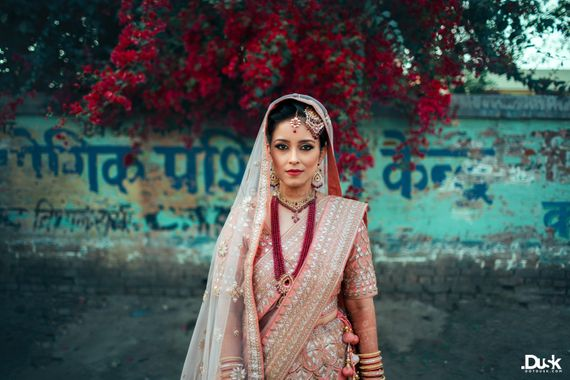 Photo of Pastel Bride Wearing Ruby Necklace