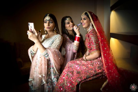 Photo of cute bride getting ready shot with her bridesmaids
