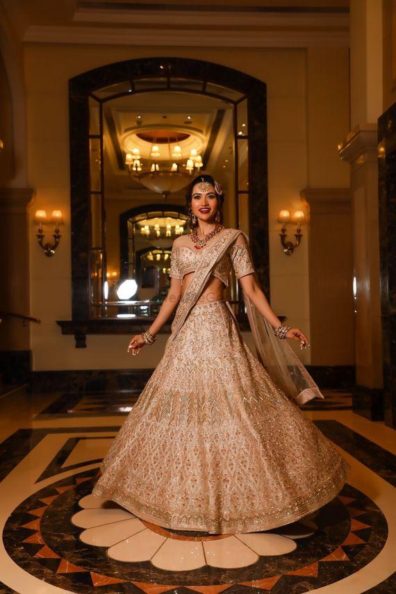 Photo of Twirling bride in shimmer lehenga