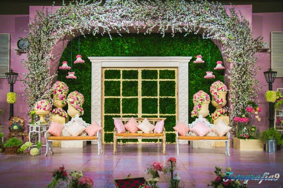 Photo of Floral Ceiling Decor with Pastel Color Seating