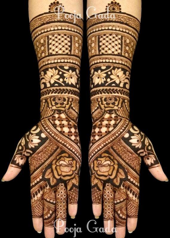 Photo of Stunning bridal mehendi with lotus motif designs