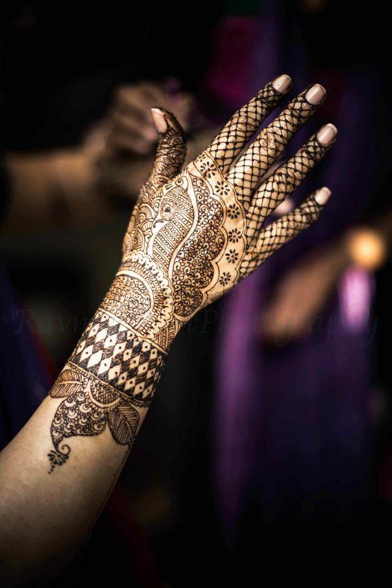 Photo of Modern bridal mehendi on back of hand