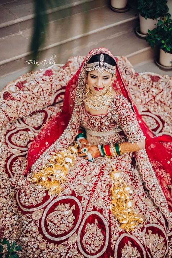 Photo of Heavily embroidered bridal lehenga top shot