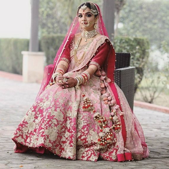 Photo of Floral embroidery lehenga in red and pink ombre