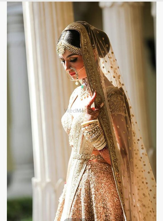 Photo of Shy bridal lehenga in all gold sequin lehenga