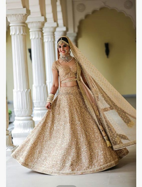 Photo of All gold sequin bridal lehenga