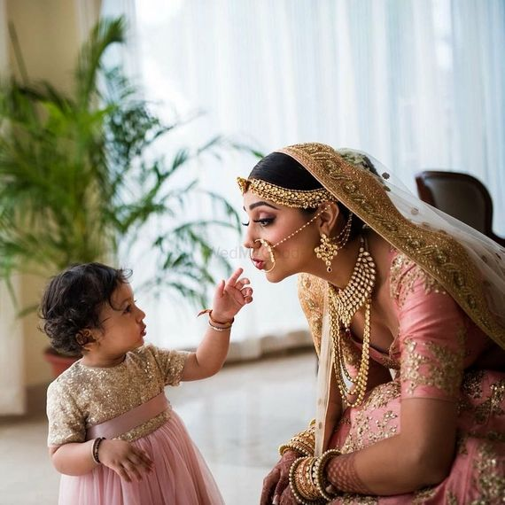 Photo of Cute bridal portrait bride with baby