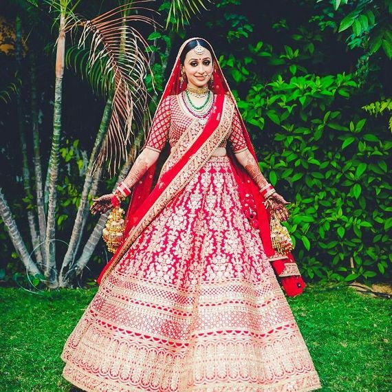 Photo of Red and gold bridal lehenga with floral motifs
