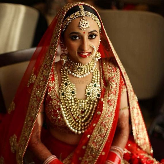 Photo of Grand bridal jewellery with red lehenga