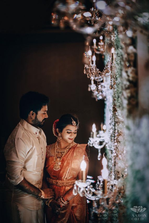 Photo of South indian couple shot with candle lit decor
